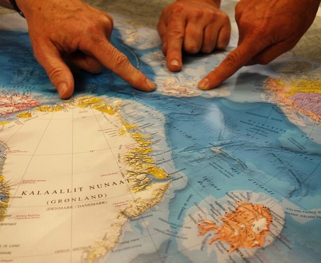 World of Maps employees point out Svalbard