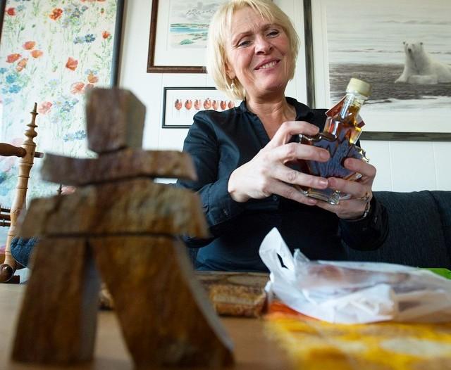 Anna Lena Ekeblad holds up some maple syrup