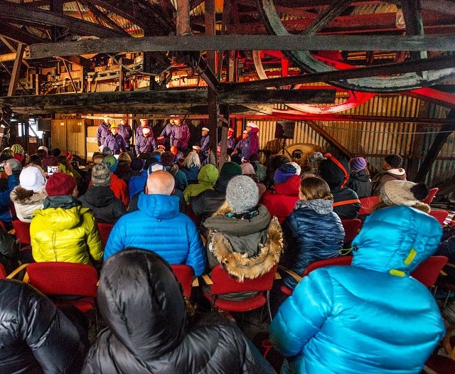 A bundled audience listens to the men's choir in Longyearbyen