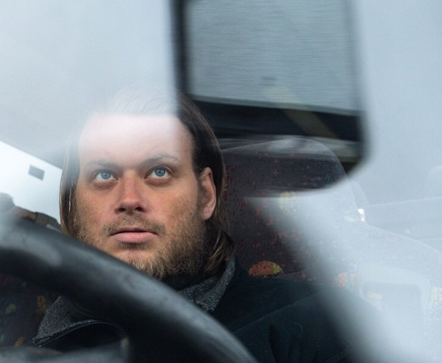 Helge Hovland through the windshield of his bus