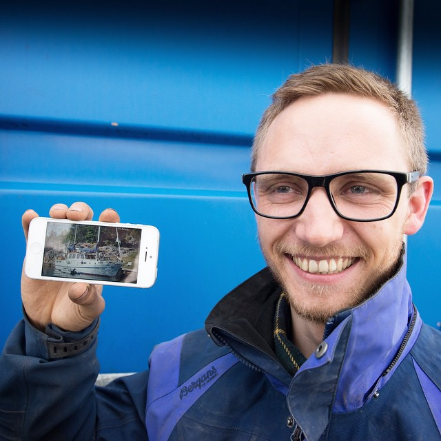 Joachim Myhrvang holds up a photo of his sailboat