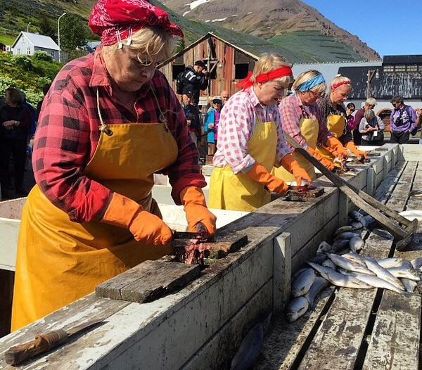 Old time herring girls reenact the work for museum goers