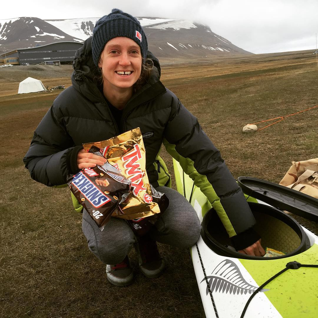 A kayaker shows off her favourite snacks