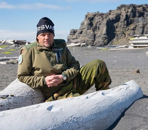 Wiggo Johansen, Jan Mayen station commander, leans up against a whale bone