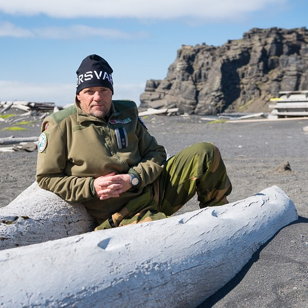 Wiggo Johansen, Jan Mayen station commander, leans up against a whale bone