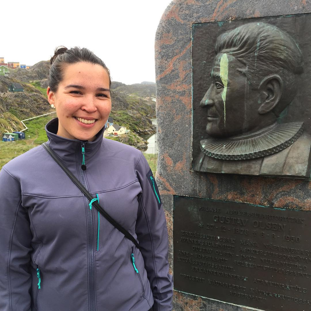 Tukumminnguaq Olsen stands by the monument to her relative in Sisimiut, Greenland