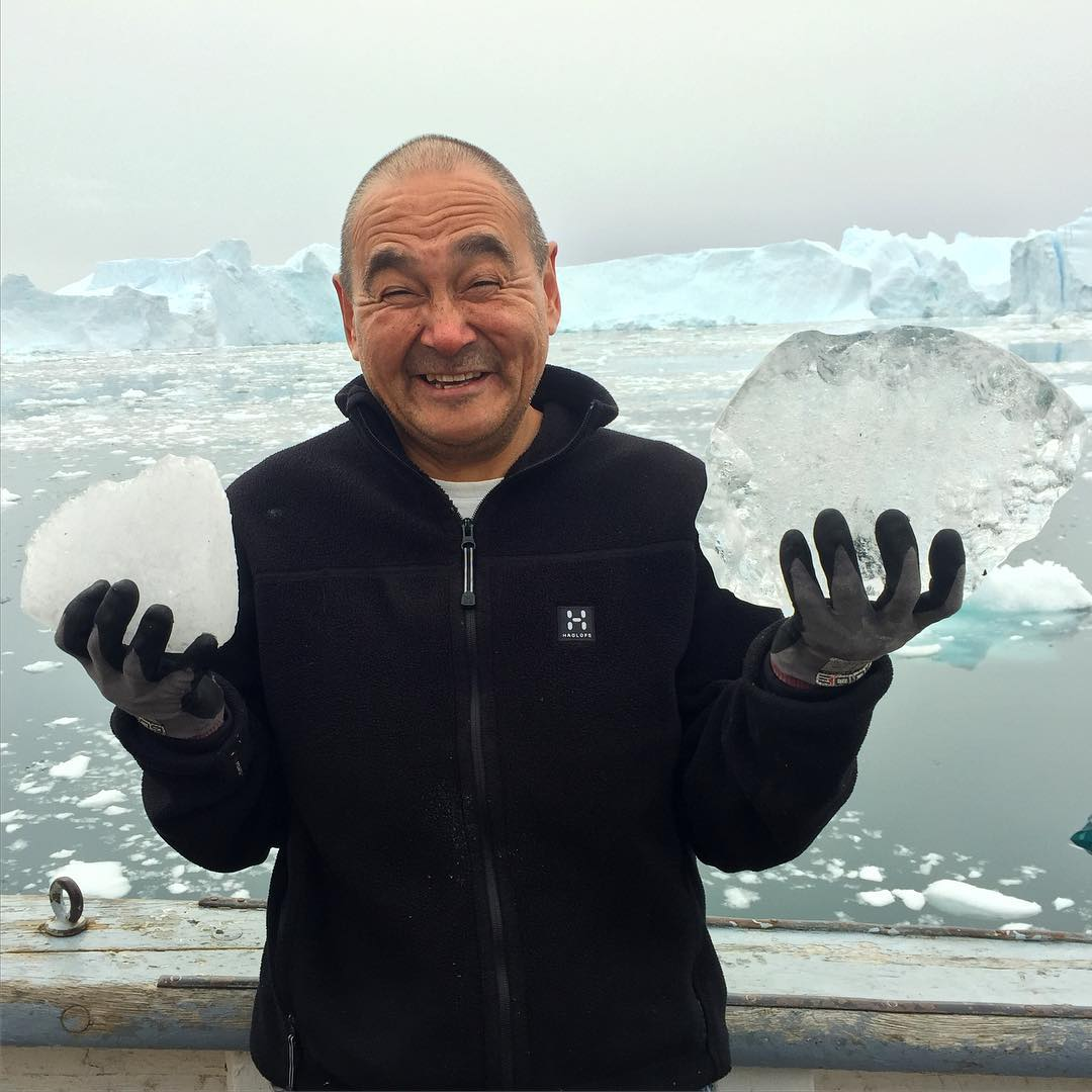 Karl-Ole Kristensen holds up two different types of glacier ice