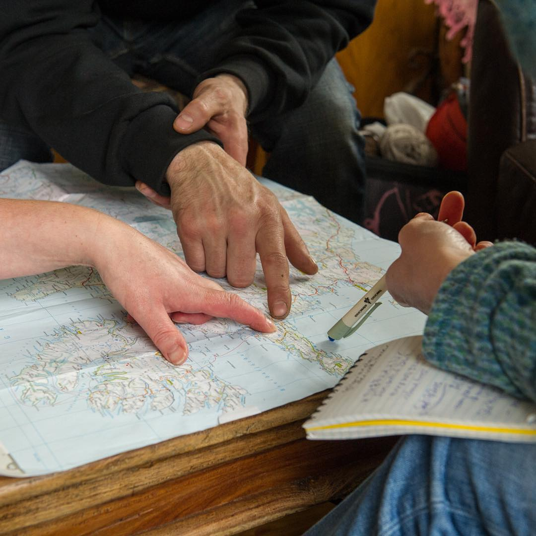 Looking at a map with Alfreð and Hildigunnur