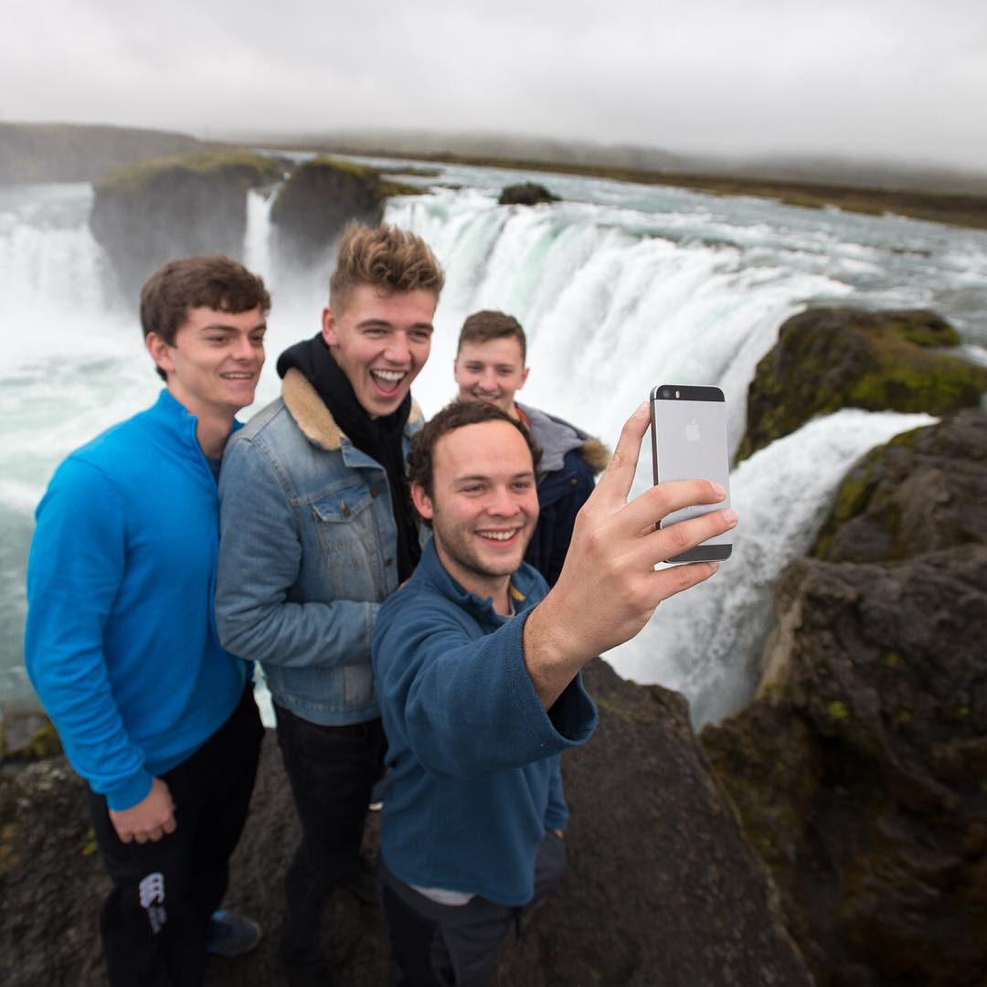Four buddies from Ireland pose for a selfie in front of Goðafoss