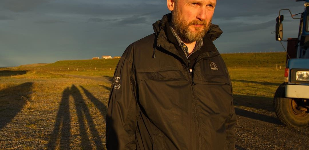 Siggeir Stefánsson near the fjord in evening light