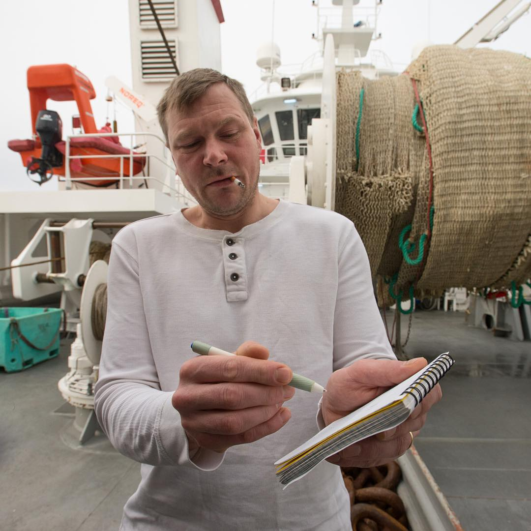 A fisherman draws a diagram to explain how his trawl nets work