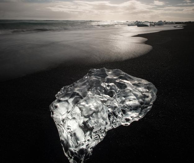 A jewel of glacier ice on a black sand beach