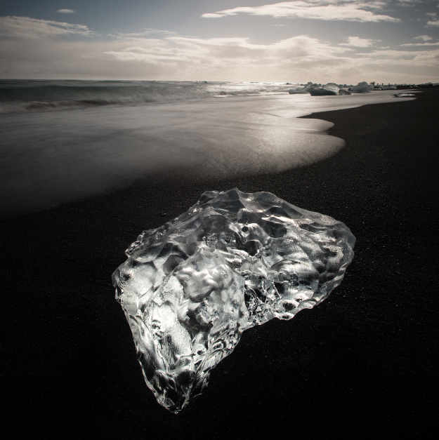A jewel of glacier ice on a black sand beach