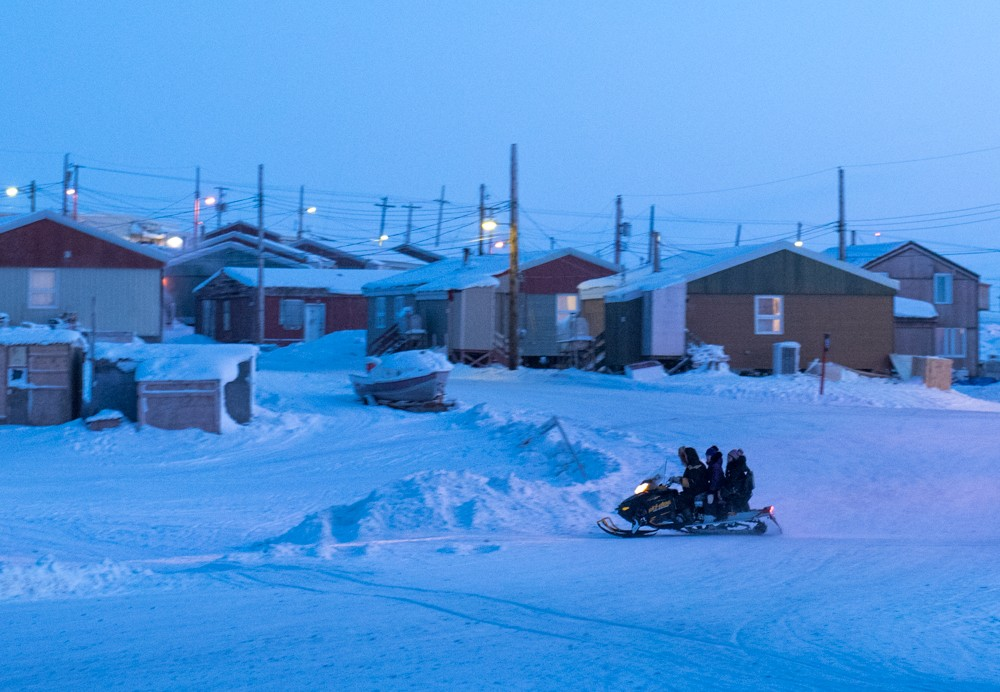 Snowmobilers in Pond Inlet