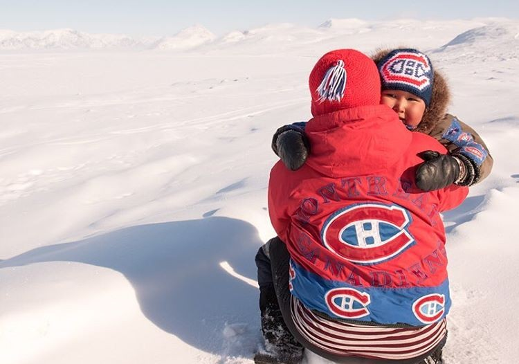 A mother and son pose in their Montreal Canadiens clothing.