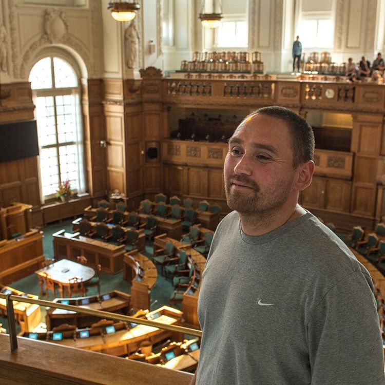Jens Heinrich stands in the Danish Parliament.
