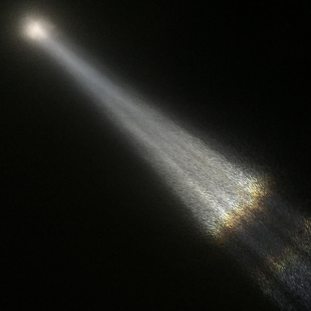 Light shines from the Imagine Peace Tower.