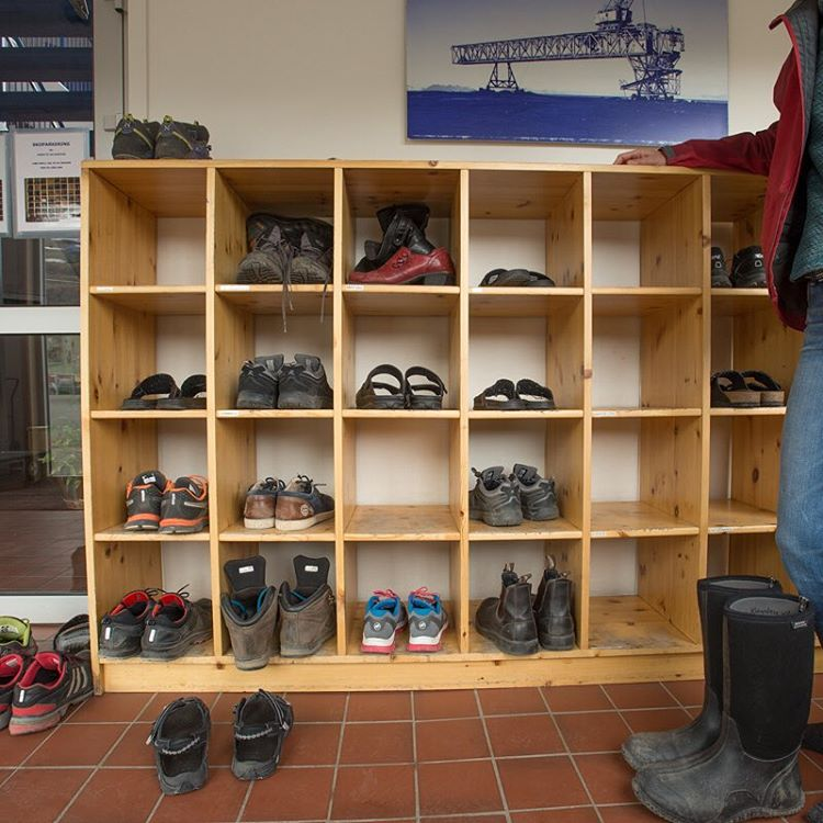 Shoes in the entrance to the Longyearbyen mining office.