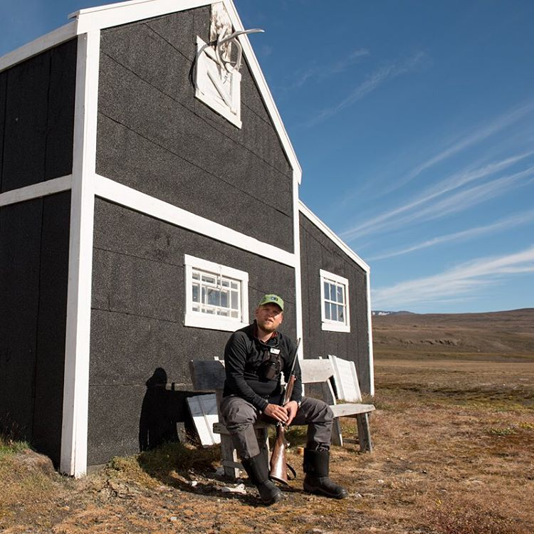 Kasper Jæger outside an old radio station in Northeast Greenland.