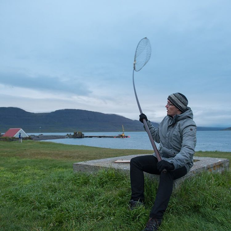 Magnus Salvarsson sits with a puffin net.