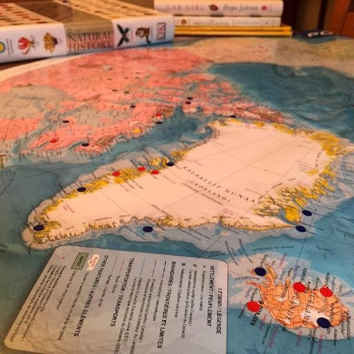 Circumpolar map with stickers of all the places Jenny has visited.