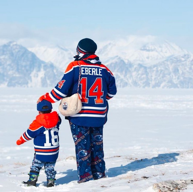Mother and son Oilers fans in Pond Inlet, Nunavut.