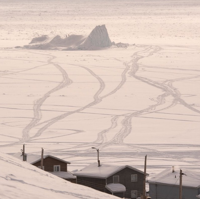 Tracks lead out to an iceberg in Pond Inlet, Nunavut.