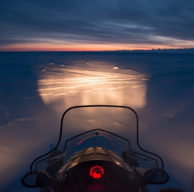 Sunset snowmobile ride on Baffin Island.