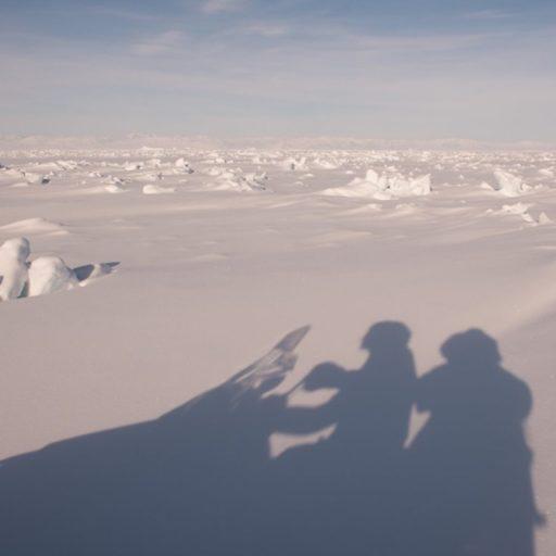 Sledding on a snowmobile in Nunavut.