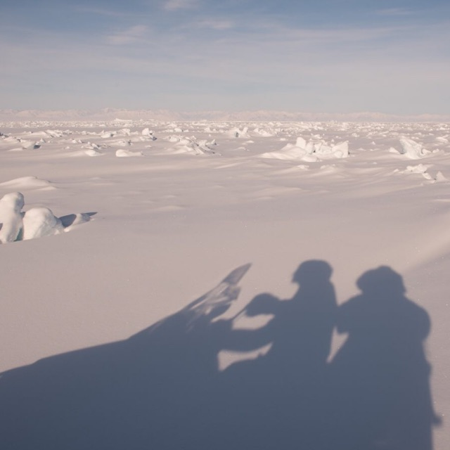 Sledding on a snowmobile in Nunavut.
