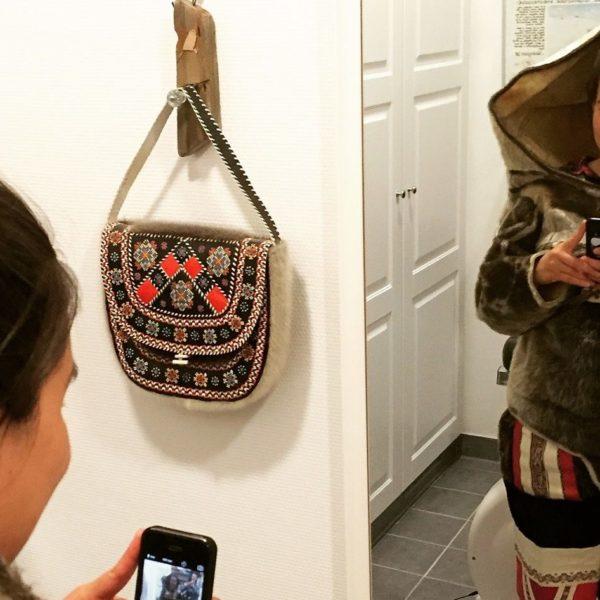 Tukumminnguaq Olsen prepares to share her reflection with the world via Instagram.