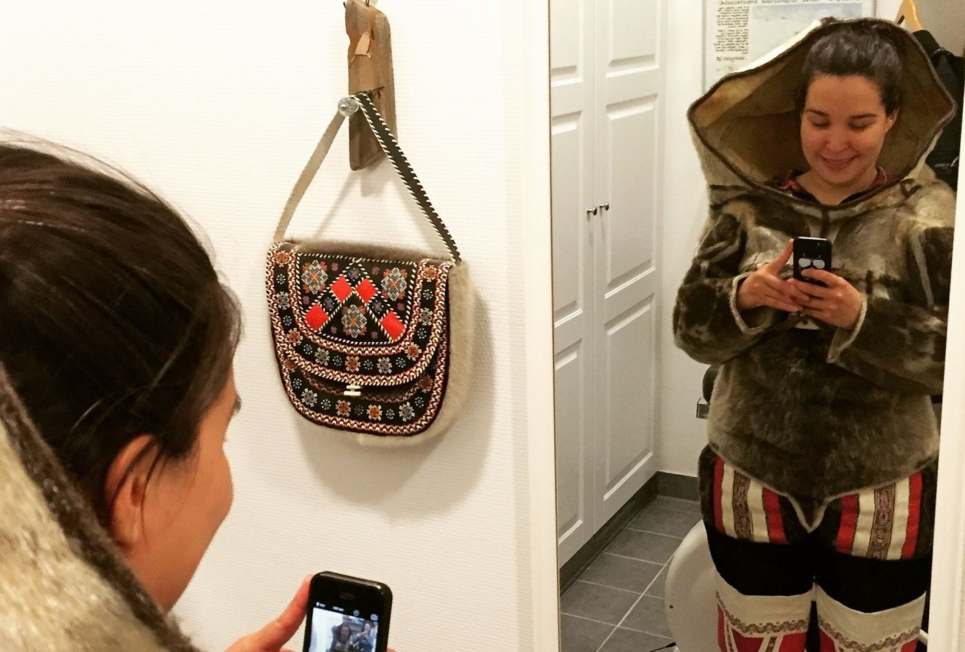 Tukumminnguaq Olsen prepares to share her reflection with the world via Instagram.