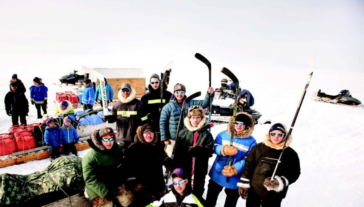The local hockey team prepares for a journey to play in Igloolik.