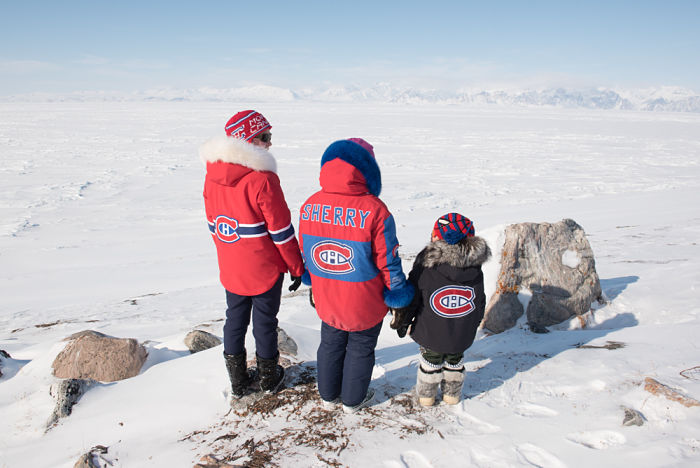 Lily Idlout, Sherry Saunders and Jaypeedy show off their homemade Montreal Canadiens parkas.