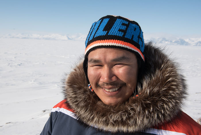 Simon Sangoya has a custom Oilers parka made by Tapisa Koonoo and a hat to match.