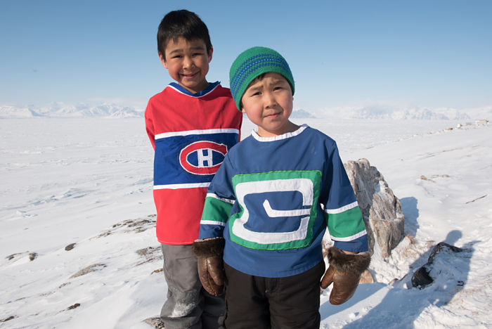 Elizabeth Inuaraq made these hockey jerseys – Montreal Candiens (left) and retro Vancouver Canuck (right) – for her sons Tony and Jack.
