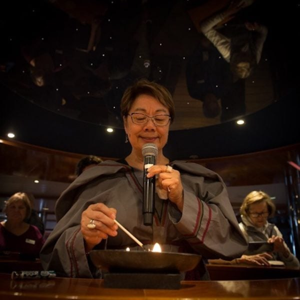 Eva Aariak lights the traditional Inuit lamp to bless our journey.