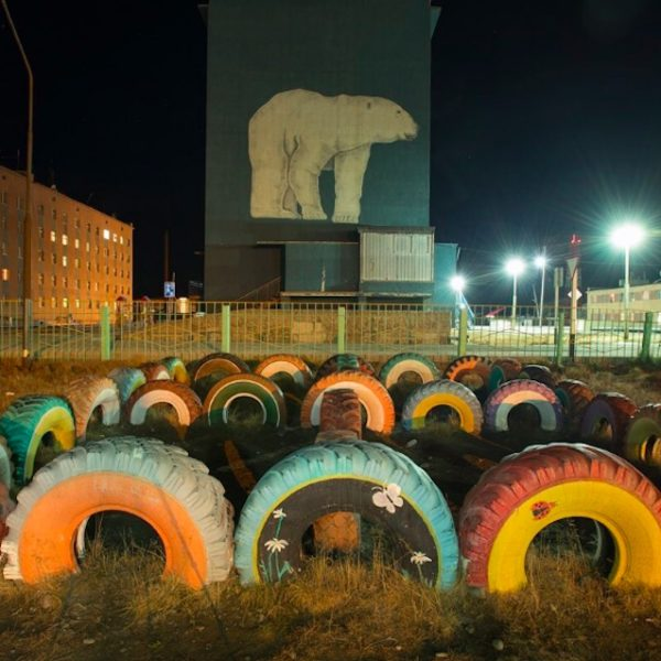 Polar bear and tire art in Russia.