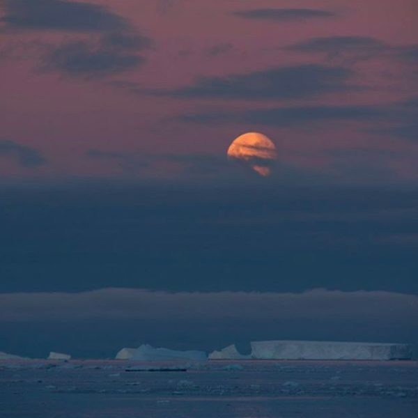 Moon over the sea ice in Antartica.