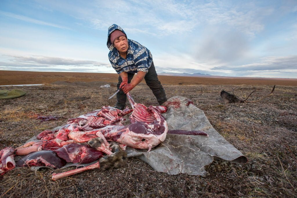 Maya with her reindeer meat in Chukotka