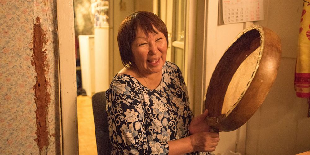 Larisa Vykvyragtyrgyrgyna rests in her kitchen in Anadyr after singing Chukchi songs she learned when she lived on the tundra.