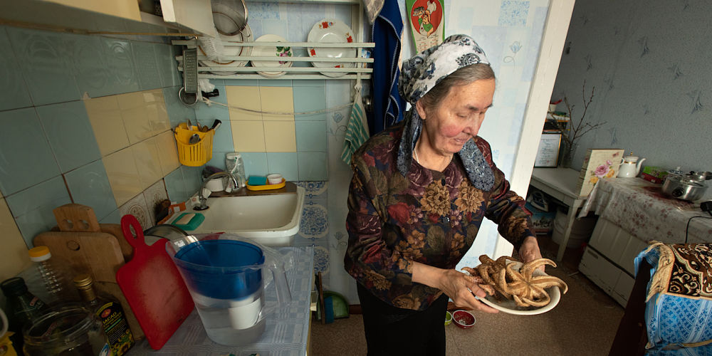 Svetlana Tagyok displays some traditional food, including sea stars, from her home region on the Bering Sea coast.